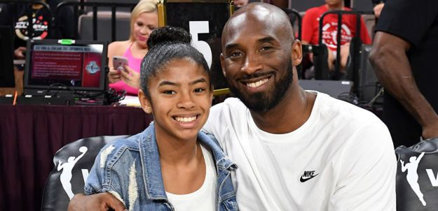 Kobe Bryant and Daughter Gianna at a game